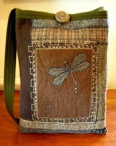 Repurposed from felted wool and other richly textured fabric. Love the dragonfly!
