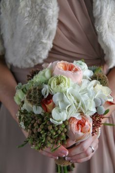 "The Bridesmaid's Posies matched their ""Cafe Latte"" Gowns perfectly and included English Garden Roses, Hydrangeas, Ranunculas and Seassonal Berries and Evergreens"
