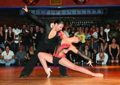 Latin dance. Salsa pose. Love: costumes & legs.