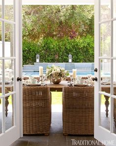 Love the chairs- Doors open from the family room to a covered terrace for casual poolside dining in Bill and Giuliana Rancic's new home - Traditional Home® Outdoor Living Areas, Outdoor Rooms, Outdoor Dining, Outdoor Furniture Sets, Outdoor Decor, Nice Furniture, Dining Area, Dining Table, A Thoughtful Place