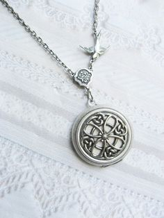 Omg I'm in love with this Celtic Locket. It has a bird too even!!