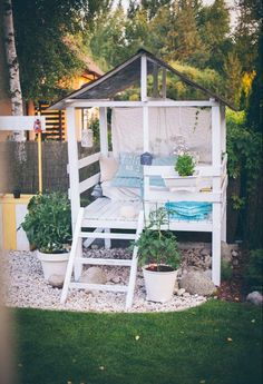 Make an adorable garden playhouse or she shed in your backyard with this easy outdoor DIY project. #shedplans