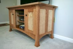 I named this my Shakashima Media Cabinet. I drew inspiration for the design from the Shakers and Japanese furniture styles. The cabinet is made of Cherry and Curly Maple with Maple as a secondary...