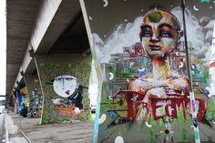 "Street art   Mural on the foreground (""MAAU"" Museu Aberto de Arte Urbana, São Paulo, Brazil) by Anjo"