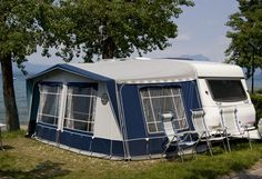 Awning of RV becomes a full tent for extra space.