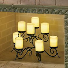 How to decorate an empty fireplace: Candles   There's no ...