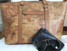 VINTAGE: Bolso de viaje hecho de cuero. Gafas RayBan originales de los 90's
