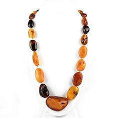 """Giant Natural Amber Necklace Item No. AM00103A01 $1,077.99 This majestic amber necklace was masterfully hand-created by Russian artisans and features an assortment of different colors, sizes, and shapes of semi-polished, luminous, authentic Baltic Sea amber stones. Each genuine amber chunk features its own natural beauty; from sparkling inclusions to rough patches, to grooves and indents. Hand-knotted in between every giant bead for added durability."