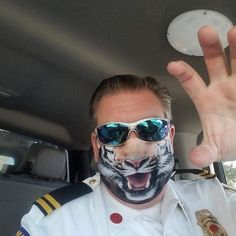 """I bought this for my boyfriend. He's a Captain with Hillsborough County Fire Rescue in Florida. He wore this mask to headquarters and everyone loved it! It put smiles on their faces and they needed that in the midst of this pandemic. Thank you so much for the great quality and quick shipping!"" - Tami . . . #evercoverfacemask #facemascover #tiger #tigeroftheinstagram #facemask #reusablemask #facemaskselfie #funny #captain Helmet Covers, Sports Helmet, Funny Face Mask, Beard Styles For Men, Roller Derby, Funny Faces, Bearded Men, Fathers Day Gifts, Textiles"