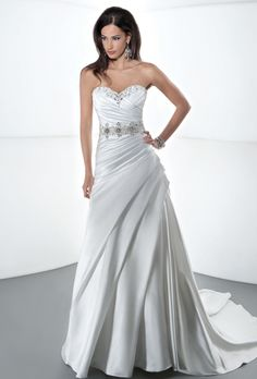 Brides: Demetrios - Sposabella. Satin, strapless, A-line with asymmetrical ruching on bodice and corset back. Neckline is embellished with crystal beading. Gown also features an attached train with pleated side drape on skirt and an attached beaded belt. Available in white, diamond white, ivory, pink, gold, and platinum.