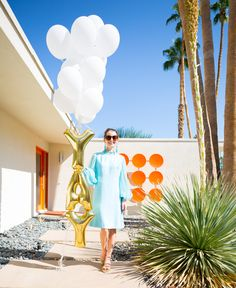 Balloon decor using gold letters // A weekend in Palm Springs ft. Kelly Golightly