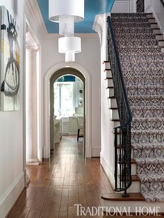 An ikat runner in shades of blue pulls from the vibrant blue ceiling of the hallway. - Photo: Emily Jenkins Followill / Design: Tish Mills