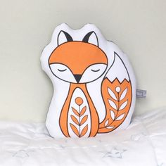 Fox cushion. He is perfect for decorating a child's bedroom or nursery or for adding something special to any bedroom. Sleepy fox has been digitally printed on cotton canvas from one of my illustrations. Patterned cotton fabric on the back. Measurements: Approx 24cm x 20cm