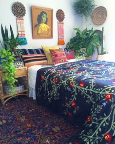 BANG!   You can't mix too many patterns & colours & themes, they used to tell me...  *Our gorgeous vintage bluehemian Persian rug *African winnowing baskets *Vintage kilim cushions from Turkey *Hmong hilltribe silk wall hangings  *Our beautiful black bone inlay box from India *Our vintage Tretchikoff Chinese Girl * Hand carved wooden wall pieces from the Ukraine *Vintage mudcloth from Africa doubling as a lumbar on the bed  *Our sweet little chinese vintage workers stool