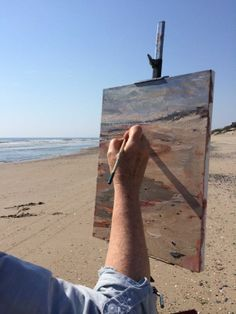 Close up of Anne painting on the beach. Catepetl Art and Frame  Anne Gibson Snyder