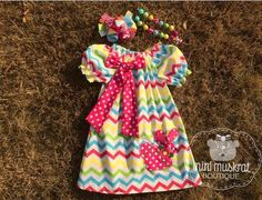 Set includes dress, bow and necklace.  This is a pre order item.