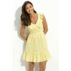 Yellow ruffle pin dot country dress Yellow dress with pin dot patterned fabric.  Ruffled hem skirt and fluttery ruffles angle down the shoulders to highlight the fitted bodice.  Waist has a little bit of stretch to slip over your head.  Fully lined.  Fishbowl brand purchased at Nordstrom.  100% cotton. Dresses