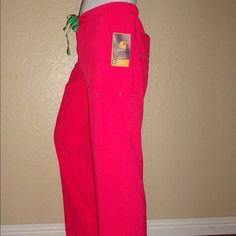 Carhartt Cross Flex scrubs pants   medical NWT Carhartt Cross Flex Vivid Pink Nurse Doctor Scrub pants   medical   lounge   Comfortable   NWT   S   Small  Color   Surf Bright Pink   Coral  Size S   Small  Spandex  Poly stretch blend   Wick Away Sweat   cross flex   Force style  Multiple Pockets   Clips   Elastic waist  Perfect for the medical professional  Perfect for lounge relax sleep time  Very soft durable comfortable by Carhartt Carhartt Pants
