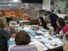 Judith enthralls the group with her free machine stitching