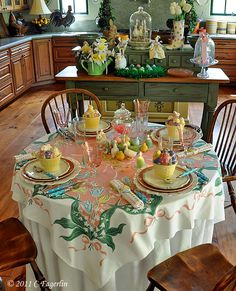 I love all of her Vintage Tableclothes ..  She plans her tablescapes around them .. Love this Easter Themed one.