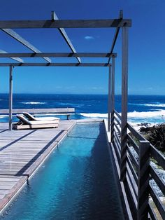 Lap pool by the ocean. Decking and lightweight pergola