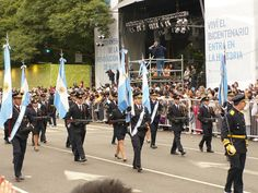 Color guards of the Argentine Air Force marching down Avenida Roque Sáenz Peña in Buenos Aires at the 2010 Argentine Bicentennial Independence Day Parade.