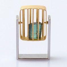 Okinari Kurokawa's pivoting caged stone ring ... love the idea of the cage...
