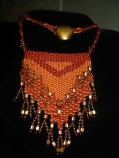 """""""Rust/Gold Cascade - 2013 - Fixed length with vintage button.  SOLD.  Woven by Terri Scache Harris, theravenscache.shutterfly.com   Hand woven, handwoven, weaving, weave, needleweaving, pin weaving, woven necklace, fashion necklace, wearable art,fiber art."""
