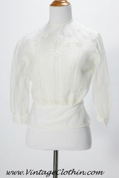 Vintage 1940s White Sheer Blouse hand detailed, made by Miss Debwin, this blouse has a pleated front detail, appliqué flowers and rhinestones, ¾ sleeves, button down back and faux pearl sleeve buttons. Truly amazing work and a beautiful blouse.   http://shop.vintageclothin.com/1940s-White-Sheer-Blouse-VC1103.htm  #1940sblouse #vintagedress #MissDebwin  #1940blouse #blouse #1940 #1940s #vintageclothin  #vintage  #vintageclothin.com #vintagefashion #forsale #buyme #white #vintageseller