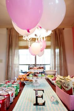 Would be cute centerpiece with baby's initial and balloons for gender or shower theme:
