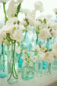 Glass coke bottle with flowers for centered prices.