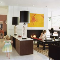 Modern lamps and lighting help distinguish a living space with an open floor plan.