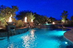 Mediterranean Swimming Pool with Custom pool waterfall, Fire bowl, Spillover jacuzzi, Pool with hot tub, Inground pool
