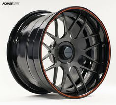 Forgeline Concave wheel features our center lock option (shown with Flush-Loc adapter installed), Gunmetal center, Gloss Black outer, and an orange pinstripe. Racing Rims, Racing Wheel, Rims And Tires, Rims For Cars, Wrx Mods, Rs6 Audi, Truck Rims, Aftermarket Wheels, Car Gadgets