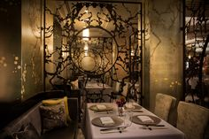 Tucked away behind double-lacquered doors, LA CHINE's exclusive private dining room accommodates up to 16 guests in a plush, Chinese-inspired setting featuring hand-painted wallpaper and a stunning two-tier crystal chandelier.