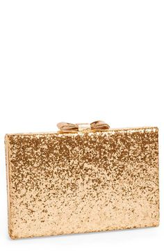 Everyone needs a gold glitter clutch. #goldrush