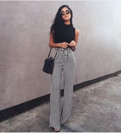 Gorgeous Striped pants with a black tee tucked in looks super stylish and chic. | Stylist Secrets: How to Make Your Legs Look Longer