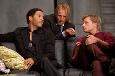 Josh Hutcherson as Peeta Mellark, Woody Harrelson as Haymitch Abernathy and Lenny Kravitz as Cinna