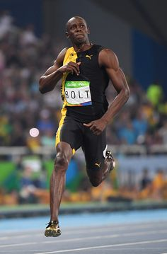 Jamaica's Usain Bolt crosses the finish line to win the Men's 100m Final during…