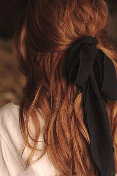 black ribbon and messy hair.