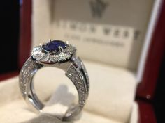 Oval blue Sapphire & Diamond ring. Made by hand in 18ct white gold. Featuring over 100 diamonds.