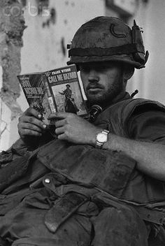 https://flic.kr/p/6F2Wp5 | U1584327 | 23 Feb 1968, Hue, South Vietnam --- Pfc. Danny Roth of Galena, Illinois, takes a reading break during a halt in the fighting here. Appropriately enough, the title of Roth's book is --- Image by © Bettmann/CORBIS