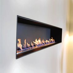 Bio Ethanol Fires of Outstanding Quality. Fuelled with bio ethanol a clean renewable energy so you can have the beauty of an open fire without a flue. Mounted Fireplace, Fireplace Inserts, Fireplace Wall, Living Room With Fireplace, Fireplace Design, Fireplace Mantels, Fireplaces, Biofuel Fireplace, Bioethanol Fireplace