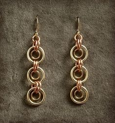 Mod Hoops in Gold and Copper, via Etsy.