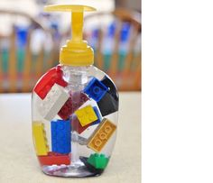 Sara at Simply Sara added LEGO pieces to a bottle of liquid soap as part of the decorations at her son's LEGO party. This could be a cute way to get your little ones to scrub up before dinner!