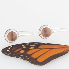 butterfly wing jewelry from BugUnderGlass - I have three necklaces from B.U.G. I definitely have room for more in my jewelry box