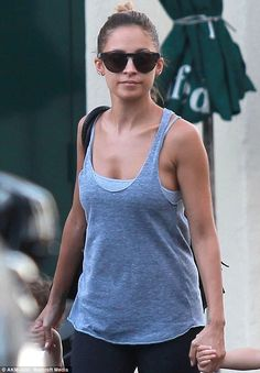Dressed down: The star appeared to be in her gym kit as she stepped out on Monday with her hair tied up and layered tops