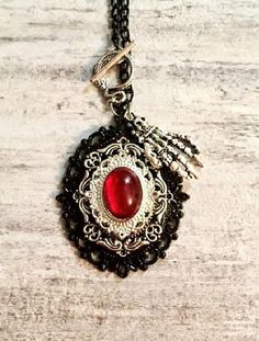 Steampunk - Victorian Gothic Steampunk Pendant Black Silver and Red Necklace Skeleton Hand Ruby Red Cabochon Layered Metal Pendant Toggle Clasp by OneStopSteamShoppe