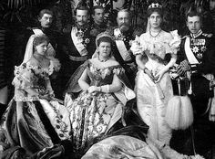 Maria Alexandrovna wears full Russian court dress from the late nineteenth century while her daughters wear non-Russian court dress in this photo.