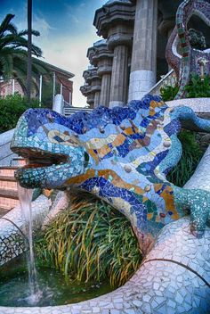 "Gaudí's multicolored mosaic salamander, known as ""el drac"" (the dragon), is one of the favorites photographic souvenirs that many tourists want to take when they visit this place. It is located at Park Güell, one of the Unesco World Heritage Sites in Barc Saint Marin, Gaudi Mosaic, Art Nouveau Arquitectura, Barcelona Architecture, Architecture Artists, Spanish Architecture, Parc Guell, Modernisme, Antoni Gaudi"